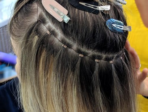 Hand Tied Hair Extensions Closeup of Application